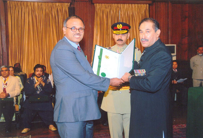 Mr. Saeed Awan (Late) Ex. Director CIWCE receiving the Tamgha-e-Imtiaz and the Citation from Governor of Punjab in the investiture ceremony held on Pakistan Day